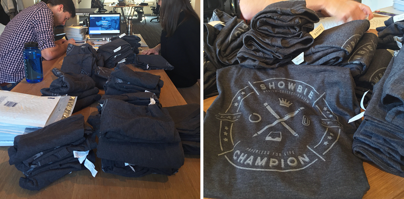 Showbie staff stuffing envelopes with Champions T-shirts